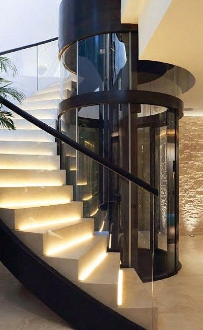 Glass Elevator and Spiral Stair