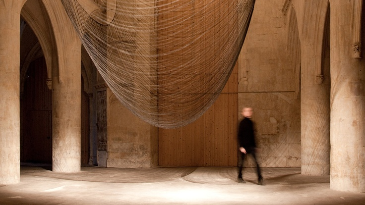 space+art=awe  300 Hanging Wires Form A Buzzing, Wiggling Inverse Arch