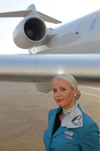Adria Airways. No doubt she is disappointed being assigned to an MD80 aircraft as she so wanted to pose in the jet intake.
