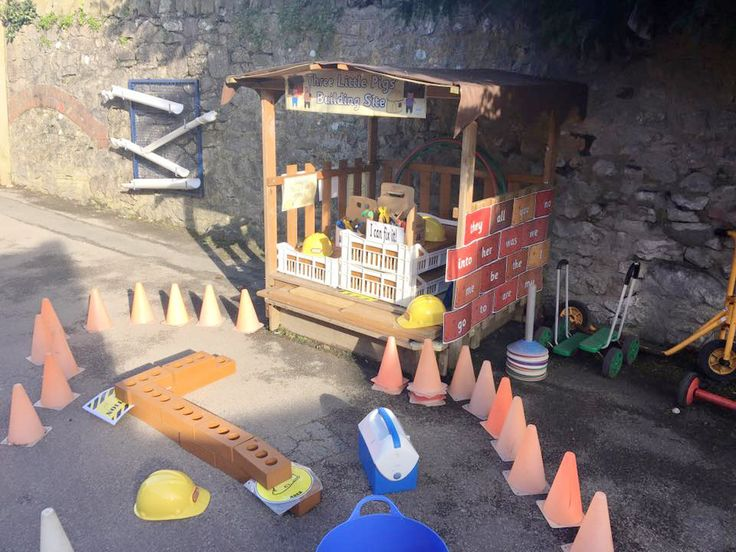 The Three Little Pigs Building Site complete with banner from Twinkl. One way of taking lessons outside!