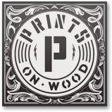 printsonwood.com    amazing prints on wood. looks better than canvas.