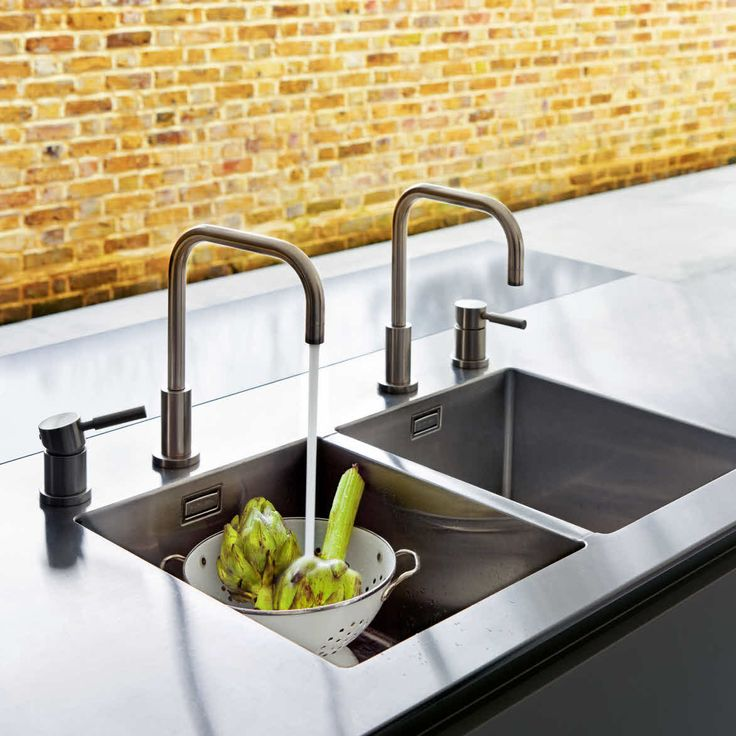 Double Sink And Faucets Built In A Quarella Composite And Welded Stainless Steel Worktop
