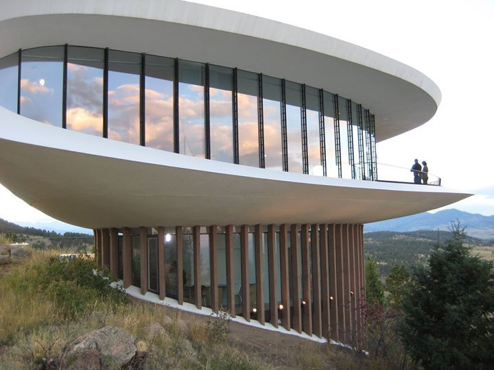 Wow!! This is the Sculptured House, also known as the Sleeper House, and it has an amazing elliptical shape. It was built on Genesee Mountain in Colorado, USA by the architect Charles Deaton in 1963. This house was also featured in the 1973 Woody Allen sci-fi comedy movied called Sleeper. Inside the house, there is a cylindrical elevator and sliding doors which were used in the Sleeper movie!