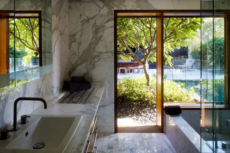 Samford House: Marble bathroom with framed views to courtyard. See more at http://blighgraham.com.au/projects/samford-house-1