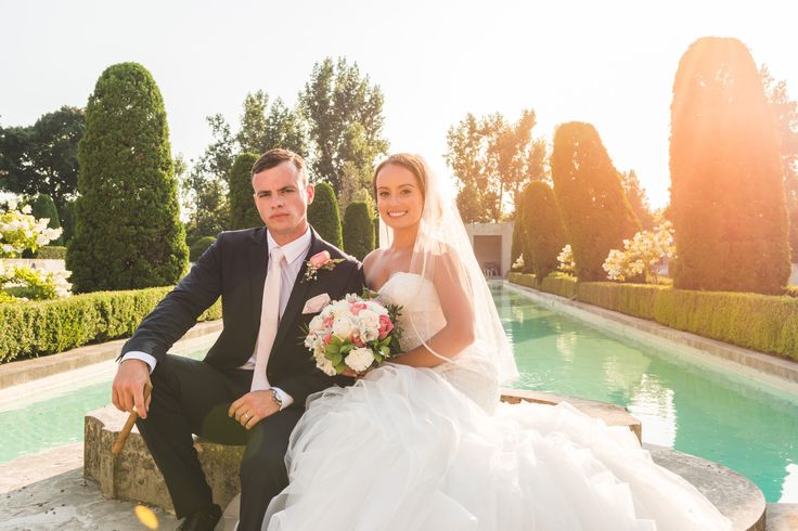 Bride and groom in front of the fountain,summer backlit glow   Parkwood Estate Wedding Photography   Toronto Wedding Photographer Pedram Navid