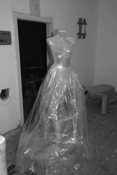 plastic cleaner bags or clear drop cloth over dress form cover with clear plastic packing
