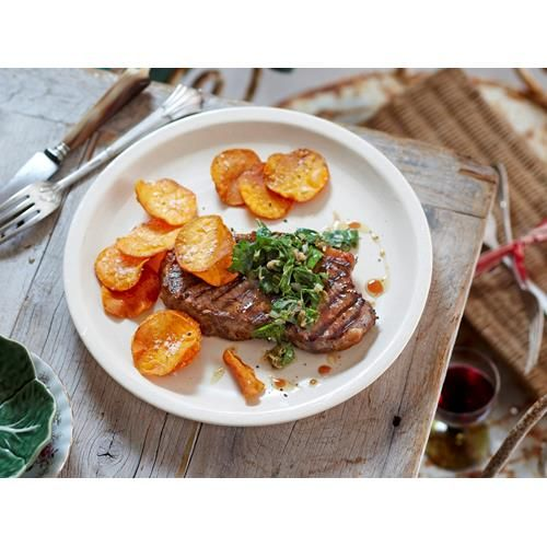 Paleo sirloin with salsa verde and kumara chips recipe - By Good Food, Packed full of protein and flavour, this healthy sirloin steak dish is great for a quick family dinner. Serve topped with a zesty salsa verde and crispy kumara chips for a delicious meal.