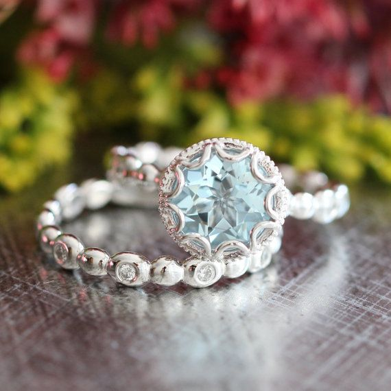 Stunning feminine and romantic! This wedding ring set showcases an aquamarine engagement ring with a 8x8mm round cut natural aquamarine crafted in a