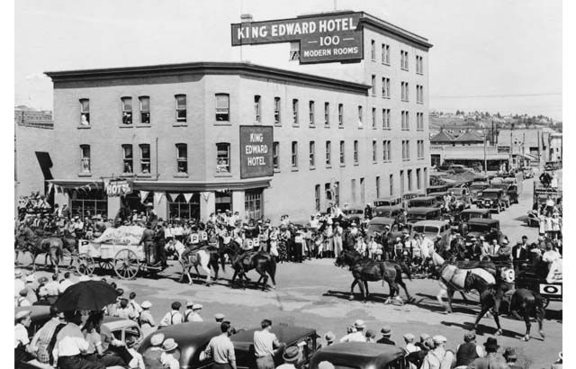 The Stampede parade passes the King Edward Hotel located at 438 - 9th Avenue S.E. in what is now known as East Village in this 1935 historical photo