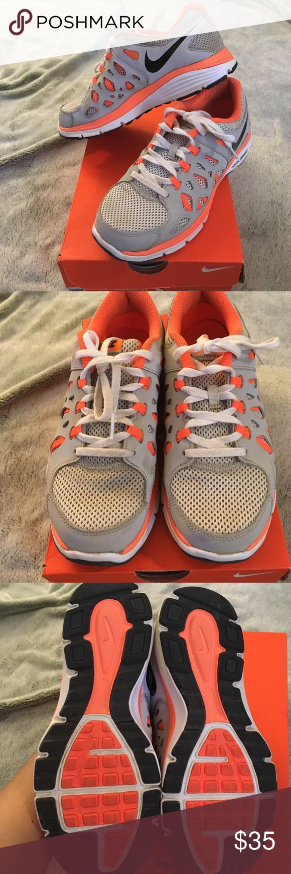 Nike Dual Fusion Run 2 (GS) grey/orange youth 4.5 Barely used Nike Dual Fusion Run 2. Size youth 4.5Y but fit me (I'm a 6/6.5 womens). Gray with bright neon orange and white with a black nike swoosh logo. Nike Shoes Sneakers