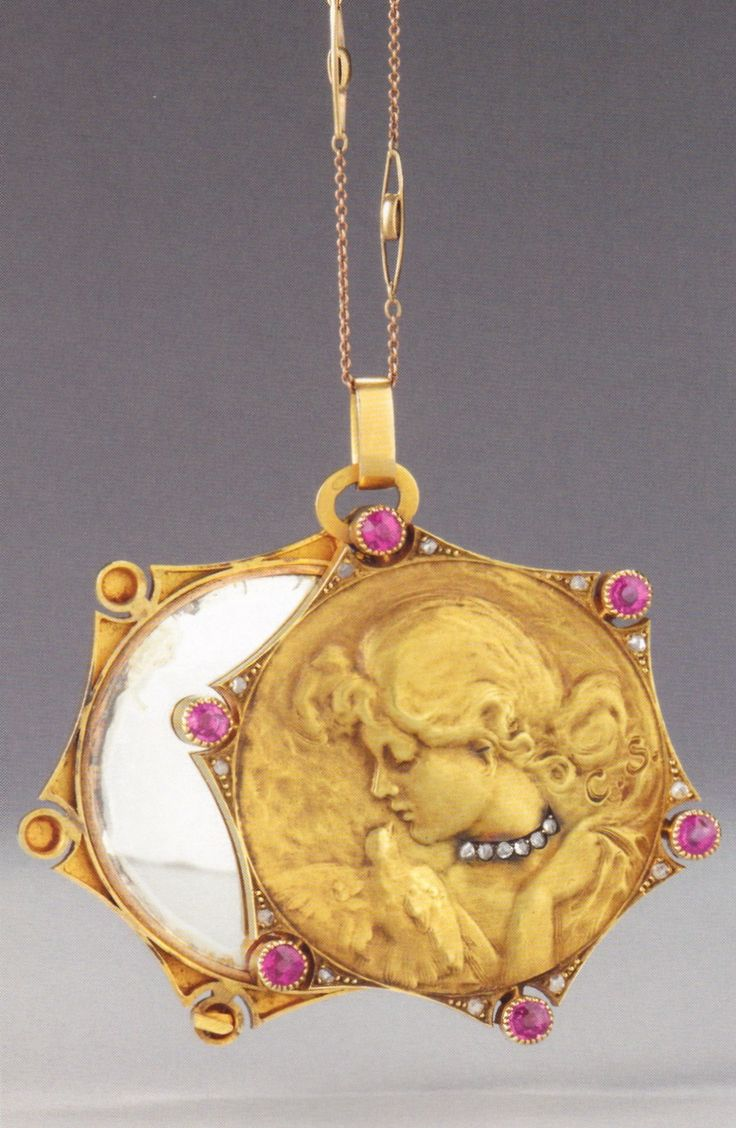 An Art Nouveau gold, ruby, diamond and glass mirror pendant, unknown maker, circa 1900-05. Previously attributed to Carl Strathmann, Munich. Source: Wolfgang Glüber, Jugendstilschmuck #ArtNouveau #pendant