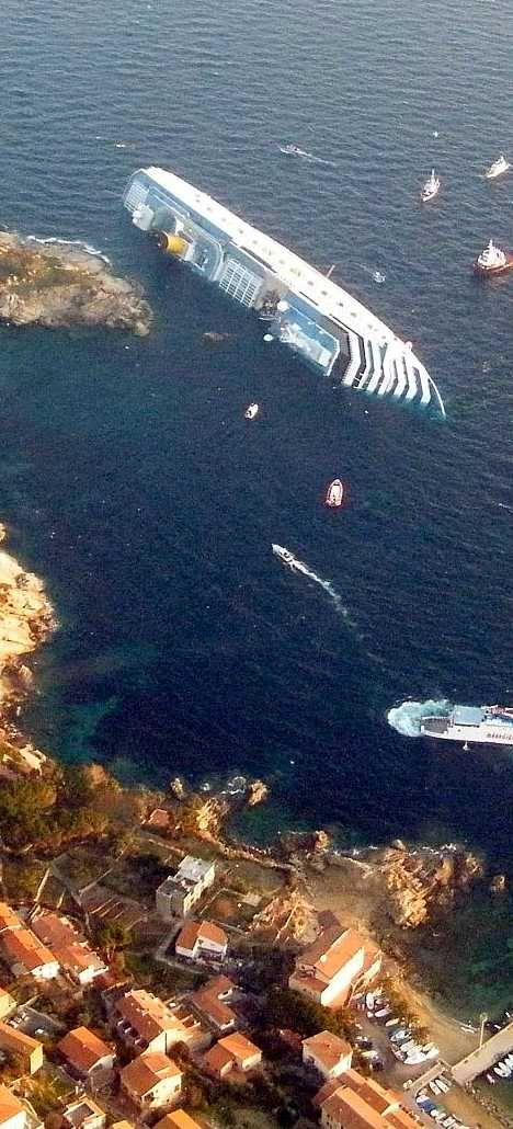 Costa Concordia. January 13, 2012. Isola del Giglio, Italy. With 3,229 passengers and 1,023 crew under the command of Captain Francesco Schettino, at 9:45pm in calm seas and overcast weather the Italian cruise ship strikes a rock on the port side in the Tyrrhenian Sea just off the eastern shore of Isola del Giglio on the western coast of Italy. The engine room floods and she loses power and propulsion, starts listing and drifts back to Giglio Island where she grounded in shallow water…