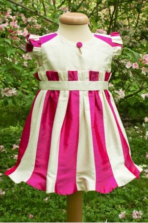 """Elegant and fun baby dress, perfect either for christening or birthday parties: """"Dots""""."""