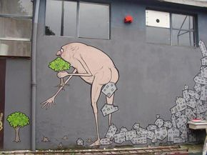 "<p>Artists at Street Art Utopia have declared ""the world is our canvas!"" In this mural the human process of transformation is all too clear! See more Street Art Utopia here. Find out Who is NemOs? here.</p>"