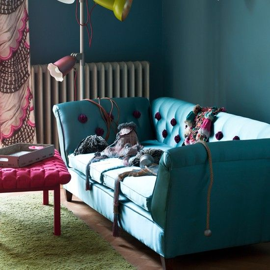 Silk upholstery in a semi-precious-stone shade takes this buttoned sofa out of the gentleman's club and into the salon. Look-at-me buttons in a striking shade add extra pizazz.