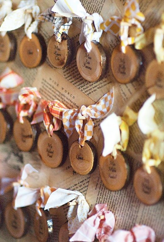 This is such a sweet idea for escort or place cards at your wedding – small wood off-cuts with your guests names written on them.  What I think really makes this idea, it the tiny cotton hangers threaded through a hole drilled into the wood, in all different fabrics.  You could use up lots of fabric scraps to create these.