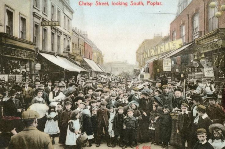 Chrisp Street, Poplar, c1905Chrisp Street ran for half a mile and was crammed with shops, barrows and stalls. Here, locals are keen to feature on a new postcard by Stengel & Co