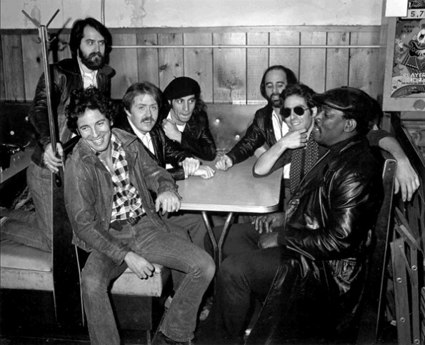 E STREET. In 1978, Garry Talent, Bruce Springsteen, Danny Federici, Steven Van Zandt, Roy Bittan, Max Weinberg and Clarence Clemons cram into a booth at Shellow's Ice Cream shop in New Jersey.