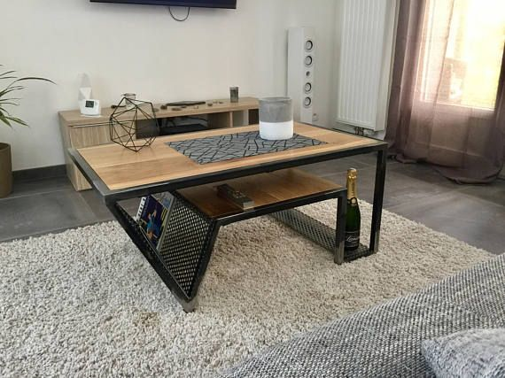 Wood & steel coffee table: This coffee table made entirely by hand and industrial design has a tray oak dimensions: 100 cm x 60 cm. The total height of the table is: 43 cm. His inventive design has made a magazine rack and a second storage tray. The use of perforated gives