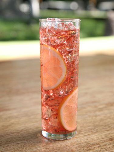 Lyte Cooler  1 oz. Voli Lyte 1 oz. Thatcher's Yumberry Liqueur 1 oz. cranberry juice 2 oz. club soda Garnish: lemon wheel  Combine all ingredients in a tall glass, stir, and garnish with a lemon wheel.