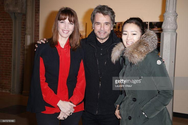 Stephanie Jarre, Jean-Michel Jarre and Gong Li attend 'Codex Seraphianus' by Luigi Serafini Exhibition at the Azzedine Alaia Galerie on March 2, 2017 in Paris, France.