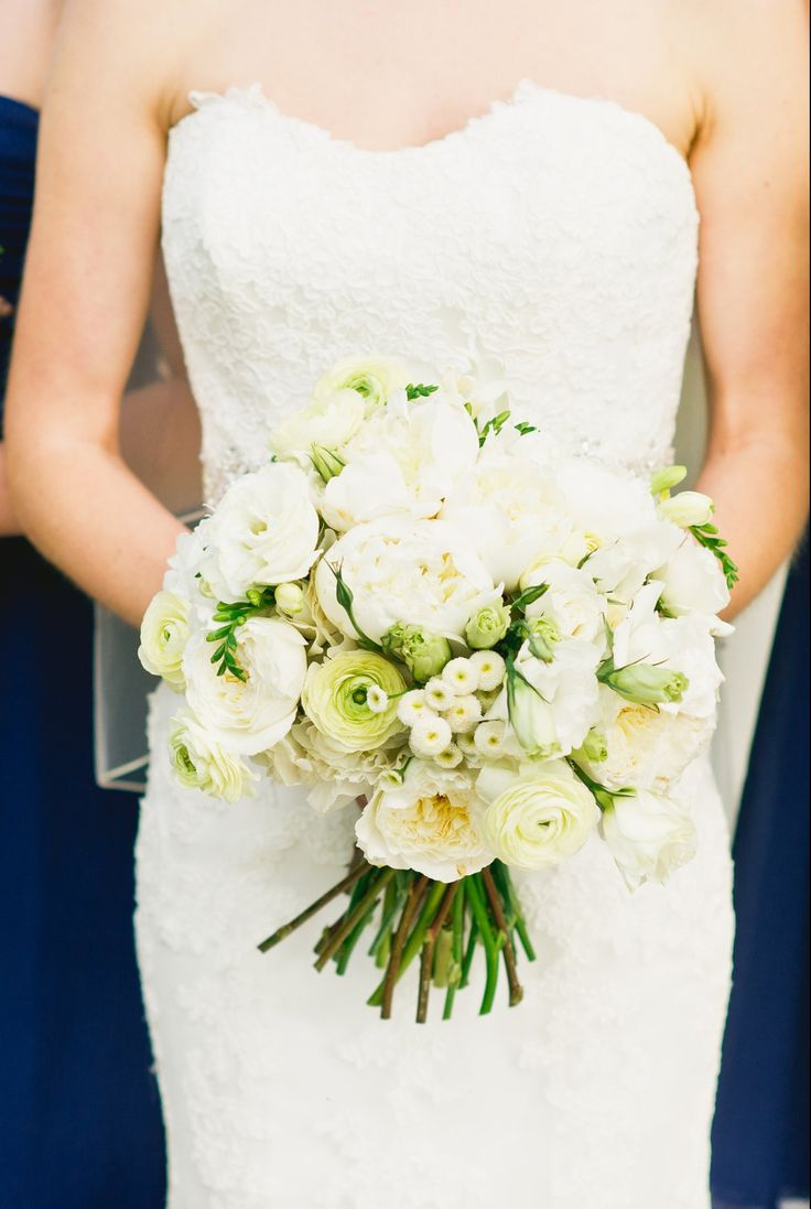 bridal bouquet of pale yellow ranunculus, patience roses, button chamomile, white freesia, white lisianthus & white majolica spray roses wrapped in cream satin ribbon