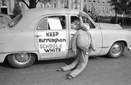 White students in Birmingham, Alabama, drag an African American effigy past West End High School, on September 12, 1963. Two African American girls attended the desegregated school and a majority of the white students were staying away from classes. Police stopped this car in a segregationist caravan in front of the school to caution them about fast driving and blowing auto horns in front of a school. (AP Photo) awesome