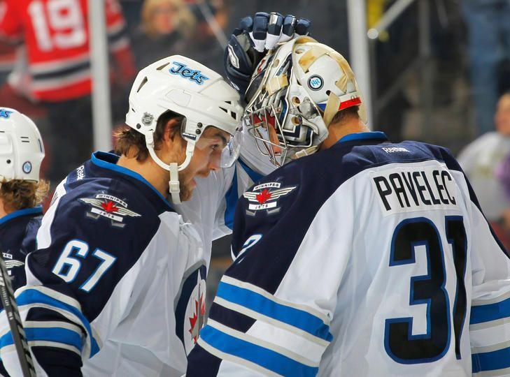 Michael Frolik #67 and Ondrej Pavelec #31 Winnipeg Jets