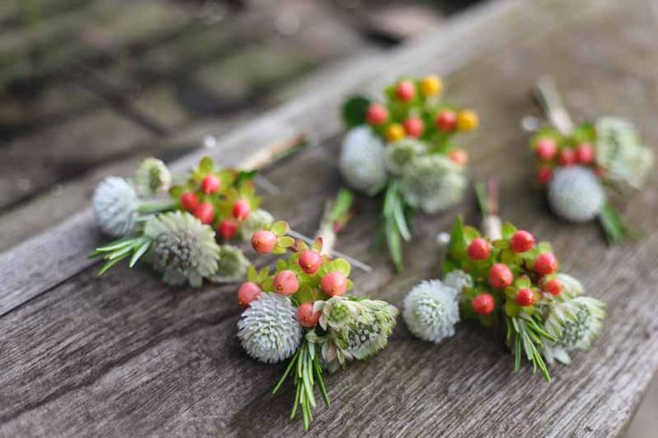 Gomphrena and Hypericum buttonholes.