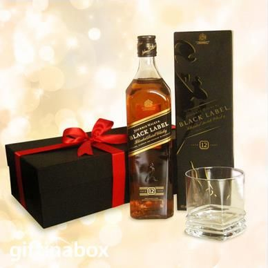 JOHNNY WALKER BLACK LABEL A bottle of Johnny Walker Black Label and a whiskey tumbler beautifully presented in a black box with red ribbons and bows. Go on, make their day!  Bottle of Johnny Walker Black Label whiskey Whiskey tumbler
