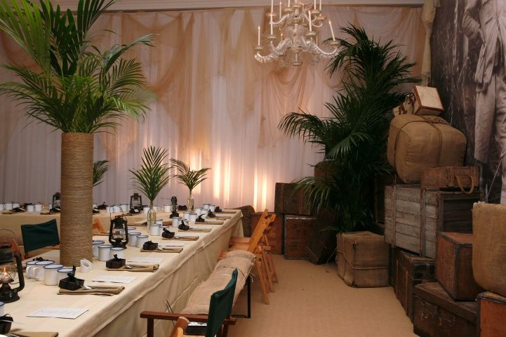 Parties — On Safari  Like the centerpiece with the twine wrapped around a vase and then palm leaves