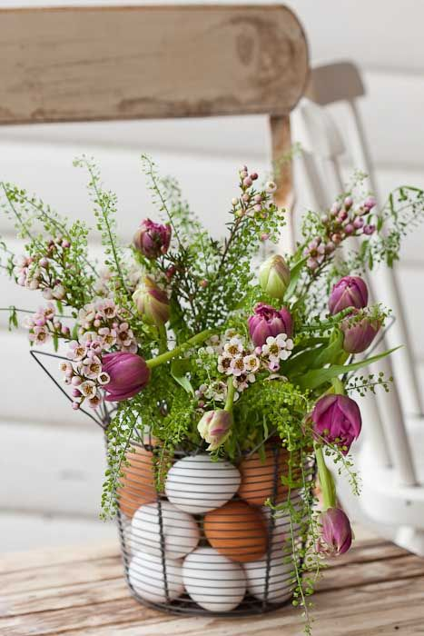 Easter Eggs  Flowers in a Wire Basket.....place flowers in a vase inside wire basket and arrange plastic eggs in between.