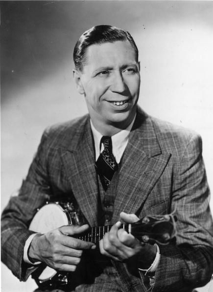 c1945: Comic entertainer George Formby (1904 - 1961) playing a banjolele. (Photo by Hulton Archive/Getty Images)