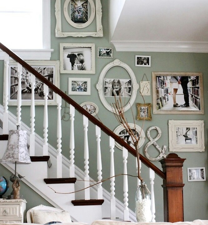 banister and steps black bars and backsteps white runner on the stairs the same color as the wall