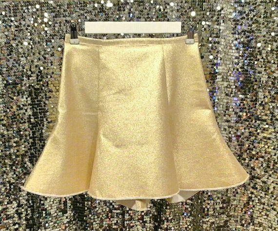 Check out this item in my Etsy shop https://www.etsy.com/listing/216080796/skater-skirt-gold-skirt-mini-skater
