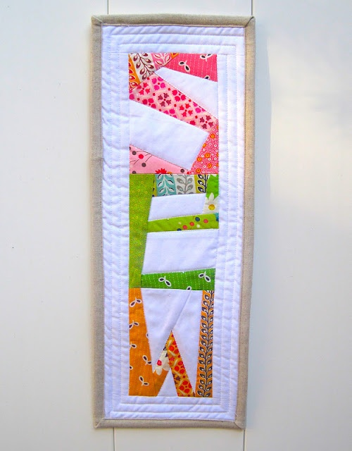"Paper pieced ""SEW"" banner to hang in my sewing/quilting room.//inspiration for piecing letters"