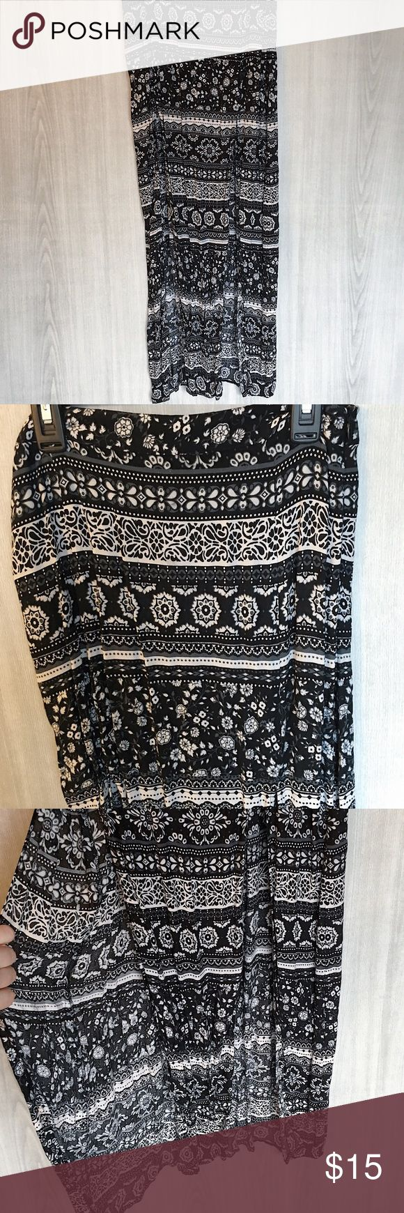 Beautiful tribal maxi skirt! You'll be a boho princess in this beautiful black tribal maxi skirt featuring two slits. Never worn, new with tags! Forever 21 Skirts Maxi