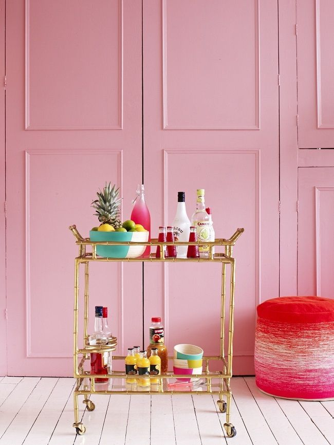 faux bamboo bar cart in gold against pink walls via Chinoiserie Chic: Styling The Summer Chinoiserie Bar Cart