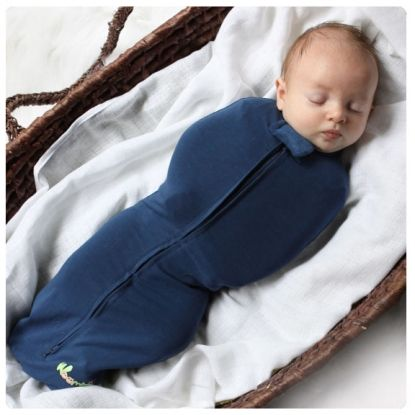 The Woombie is a safe & natural way to swaddle your baby, allowing and encouraging baby to softly stretch their extremities as needed- just like in the womb. It comforts, softly confines arms, hugs the tummy (great for colic) and gently cocoons baby's unique curves... preventing Startling issues, face scratching, overheating and also preventing dangerous loose unraveled blankets from covering baby's face.