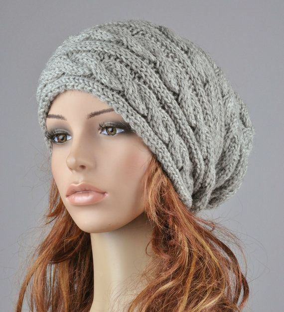 """This hat features on an cable pattern and suits any outfit style. It is made of soft wool blend yarn in nice grey color.  Length:11"""" from top to bottom Circumference: 18"""" (relaxed) 24"""" (stretched) – fit any size head!  Hand wash in cold water with detergent or shampoo and lay flat until dry.  It is knitted in my pet-free and smoke-free home.This one is in stock and ready to shipping."""