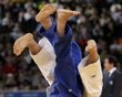 Japan's Masashi Ebinuma fights with Kazakhstan's Sergey Lim in men's -66kg elimination judo match at London 2012 Olympic Games