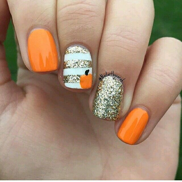 Halloween nails – orange with all gold glitter nail and white with gold stripe and pumpkin art nail
