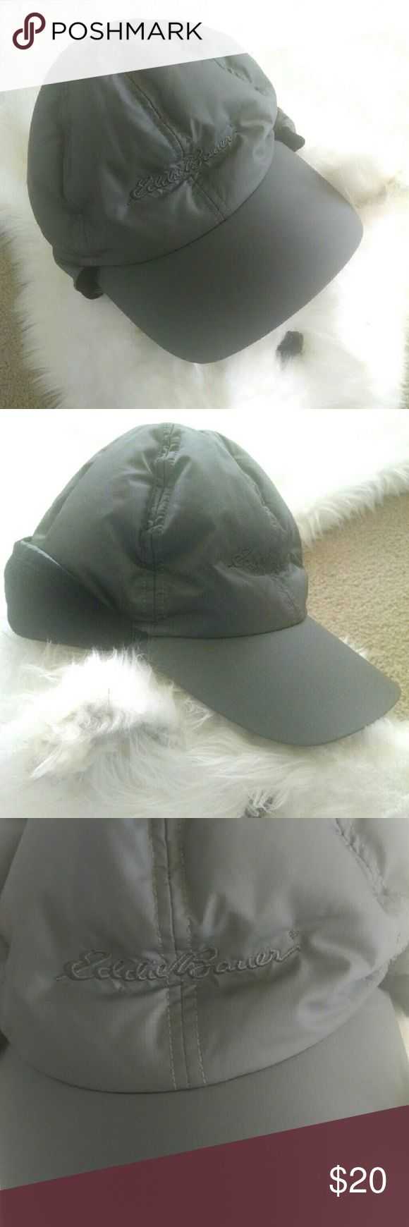 Eddie Bauer Earflap Winter Hat S/M Grey goose down-filled, fleece-lined baseball cap style hat. Can be worn with the ear flaps up or down. Non-adjustable, inside measures about 21 ??. ?In very good condition, just two light scuffs on the topside of the bill. Comes from a smoke free, pet free home. Eddie Bauer Accessories Hats