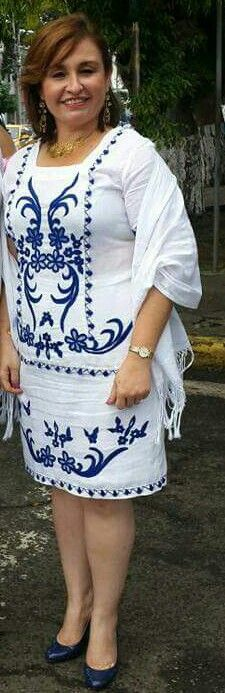 Royal blue embroidery on white dress