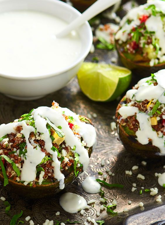 Stuffed Grilled Avocados recipe are a vegetarian delight! Quinoa, avocado, and the tasty flavors of V&V Supremo® Mexican Sour Cream and Sierra® Cotija Cheese make these a delicious addition to any menu. #LoveMyQueso