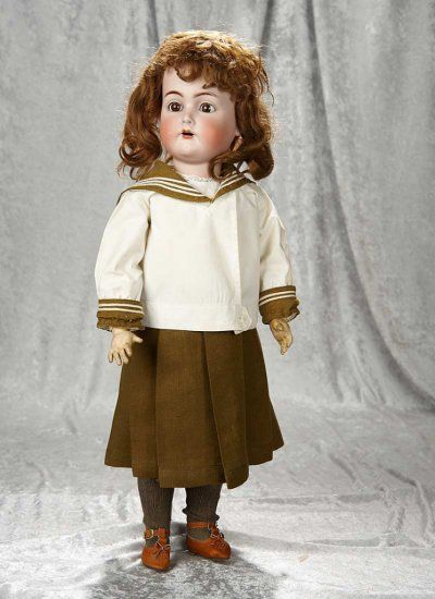 "24"" German bisque child, 403, by Kammer and Reinhardt in antique sailor costume ~~Bisque socket had, brown glass sleep eyes, painted feature, open mouth, four porcelain teeth, brunette mohair wig, dimpled chin, composition body with ball-jointing at shoulders and hips, hinge-jointing at hips for walking style body. Marks: K*R Simon & Halbig 403 Germany. Generally excellent. Kammer and Reinhardt, circa 1912, the doll wears antique sailor costume."