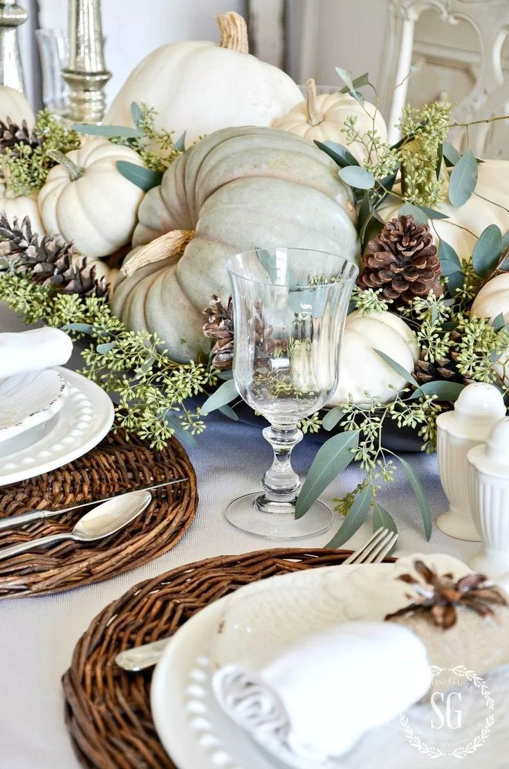Rustic Thanksgiving Tablescape with pumpkins and greenery.