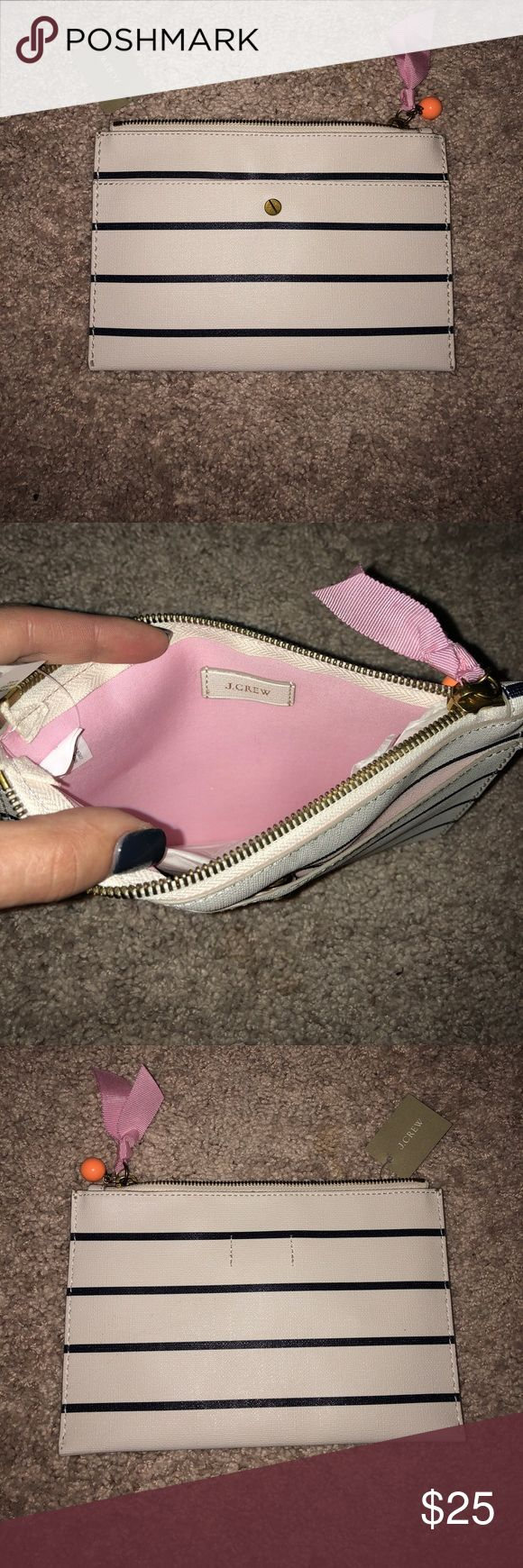 NWT Jcrew clutch New with tags, never used, jcrew clutch. Beige/cream with navy stripes with cute pink ribbon and orange detail on zipper. Holds an iPhone 8, small wallet, lipstick. J. Crew Bags Clutches & Wristlets