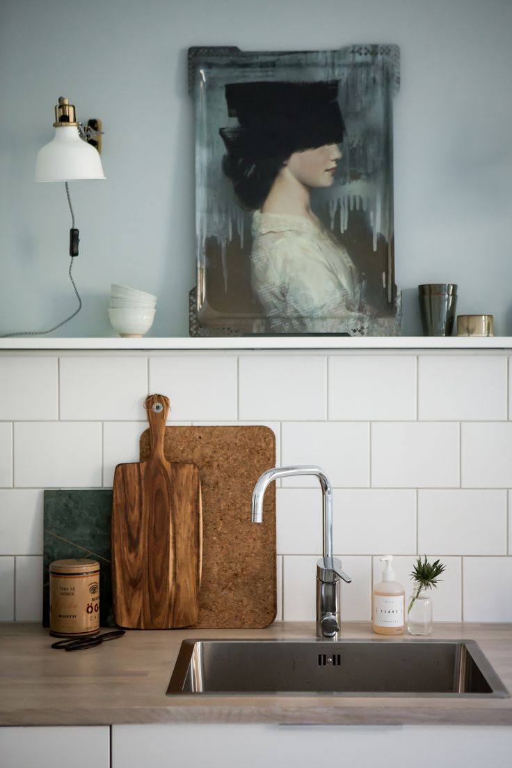 I love the idea of placing art in the kitchen. It seem as if it doesn't belong, but adds lots of interest.