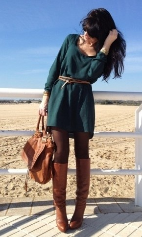 belted sweater dress and tall slouchy brown boots with dark nylons